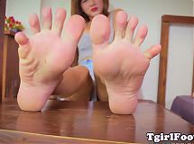 Asian tranny curls her pedicured toes