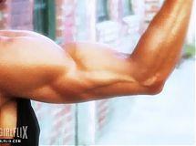 Muscular Woman Flexing Biceps