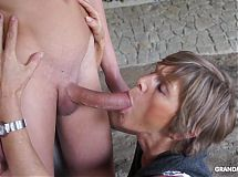 Horny old cougar tapes up her young toyboy and sucks him off